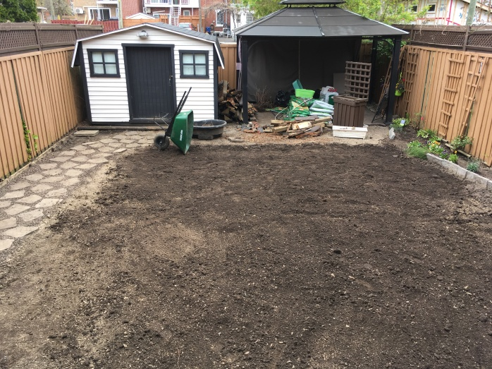 backyard DIY renovation remodel stone path tilling raking soil