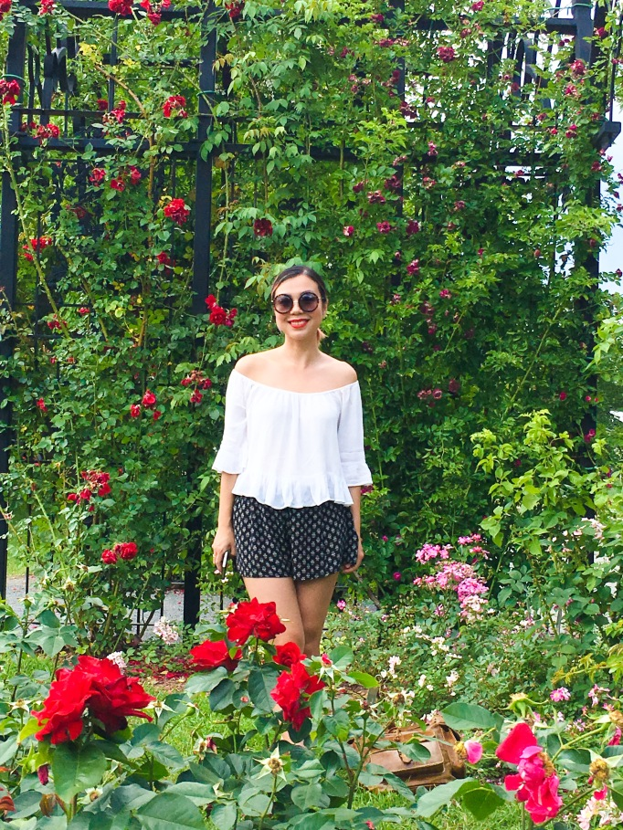 Montreal Botanical Garden climbing roses Urban Planet off-the-shoulder top Forever 21 shorts sunglasses Asos sandals leather backpack