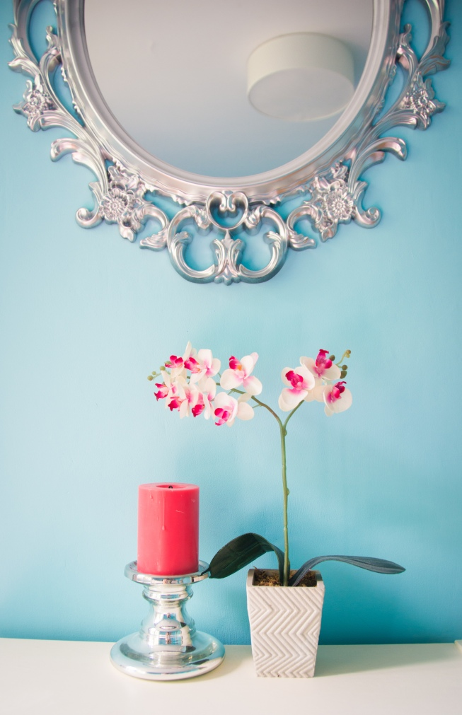 guest bedroom decor style interior decorating Ikea ornate mirror orchid coral candle