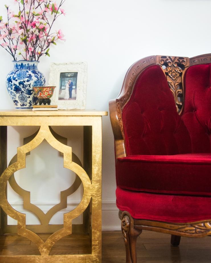vintage red velvet armchair moroccan side accent table white and blue procelain vase eclectic antique bohemian home living room decor