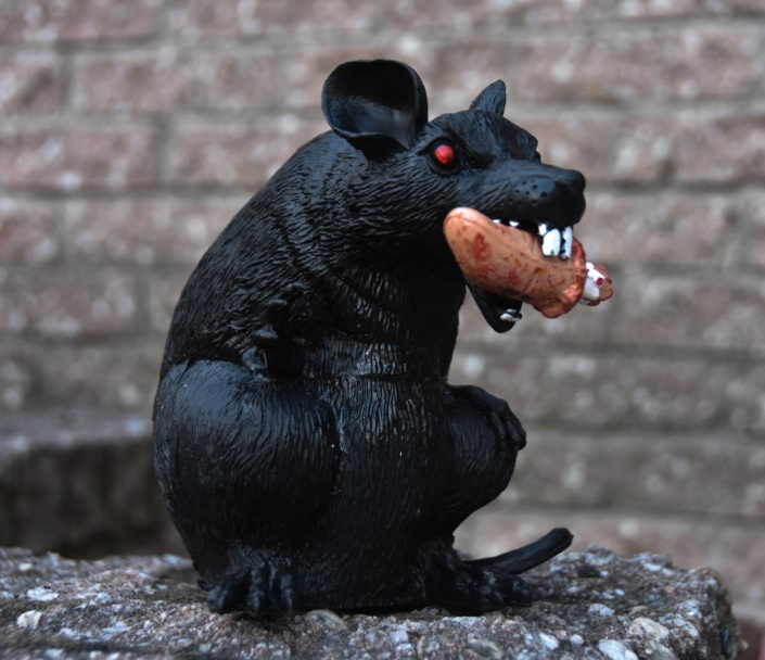 Halloween outdoor decor rat eating human thumb