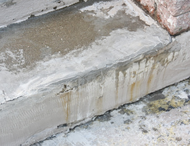 DIY concrete stair step repair after photo chips fixed