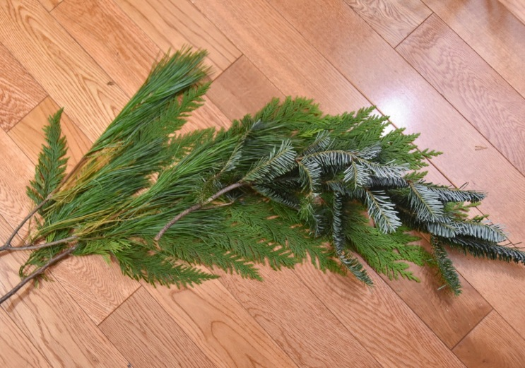 DIY christmas holiday mantle fireplace garland real evergreen start building shape