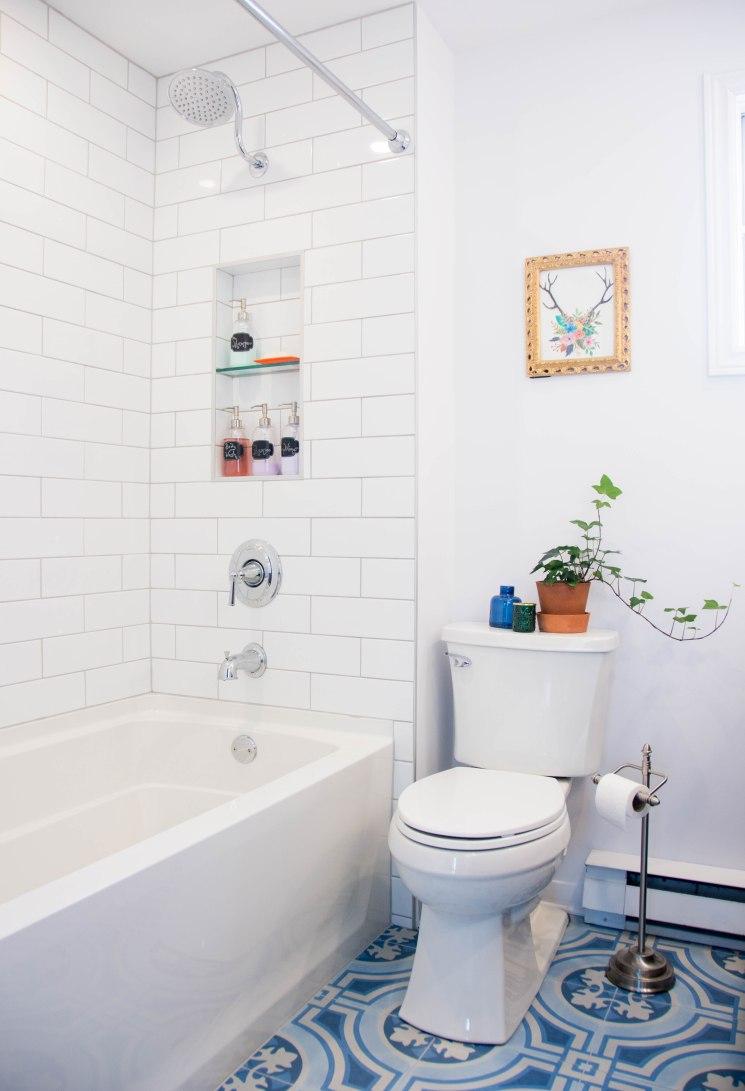 white subway tile gooseneck shower niche Kohler bathtub bathroom remodel renovation porcelain blue mosaic British Portuguese floor tile Kohler Elliston toilet