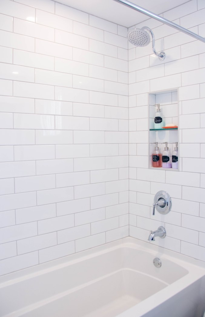 white subway tile gooseneck shower niche Kohler bathtub bathroom remodel renovation